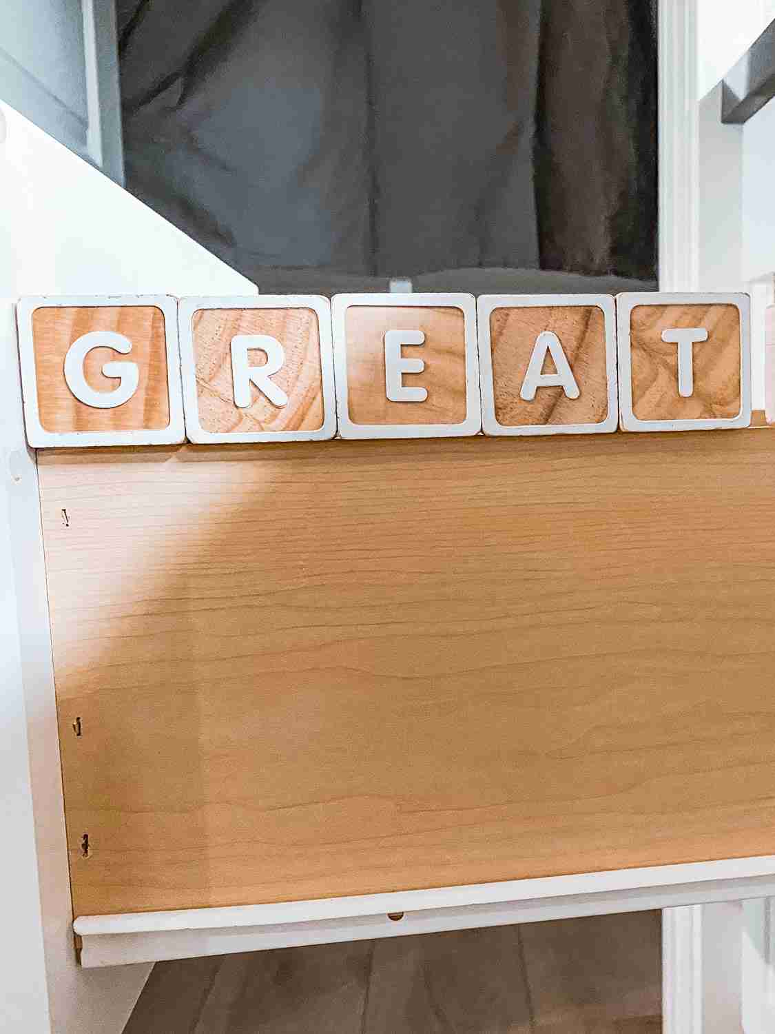 Blocks spelling GREAT inside drawer for Midway Mania for Disneyland at home