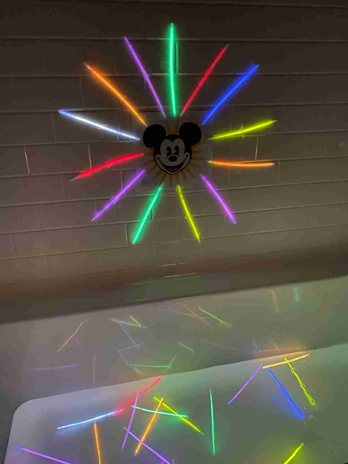 Glow sticks in bath and on wall to replicate World of Color for Disneyland at home