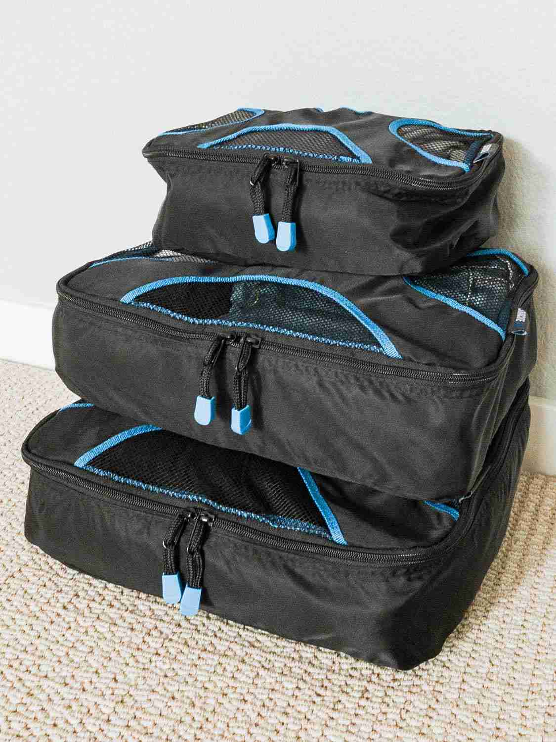 Shacke Pak packing cubes stacked and ready to pack for minimalist travel