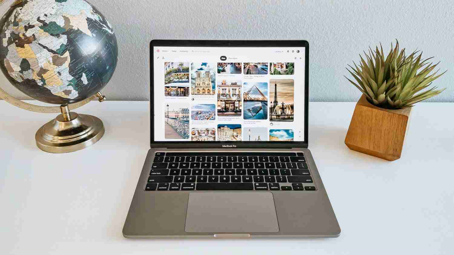 Laptop on desk with Pinterest images of places to go on family trips