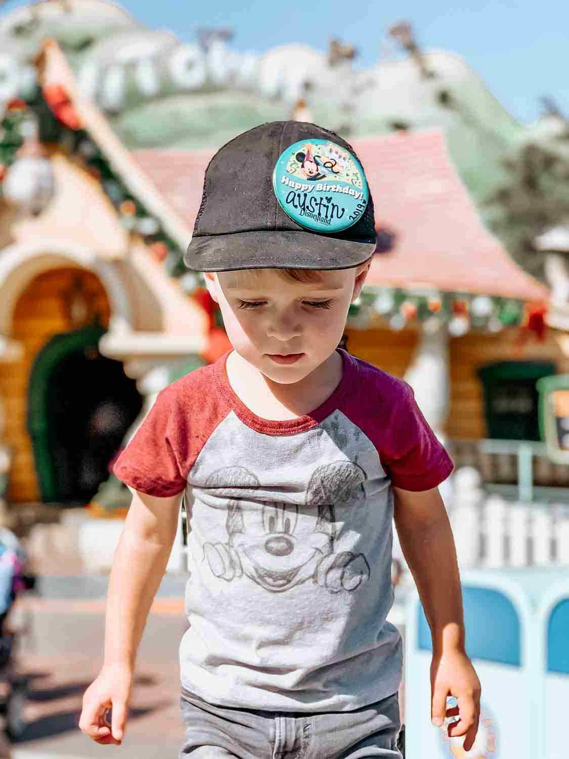 Little boy wearing Mickey Mouse shirt at Disneyland in Toontown