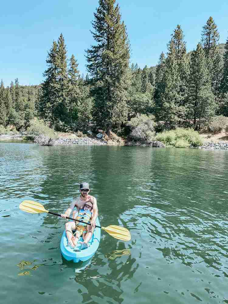Father and son kayaking on Bass Lake California