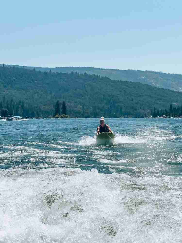 Mom on ZUP board on Bass Lake California
