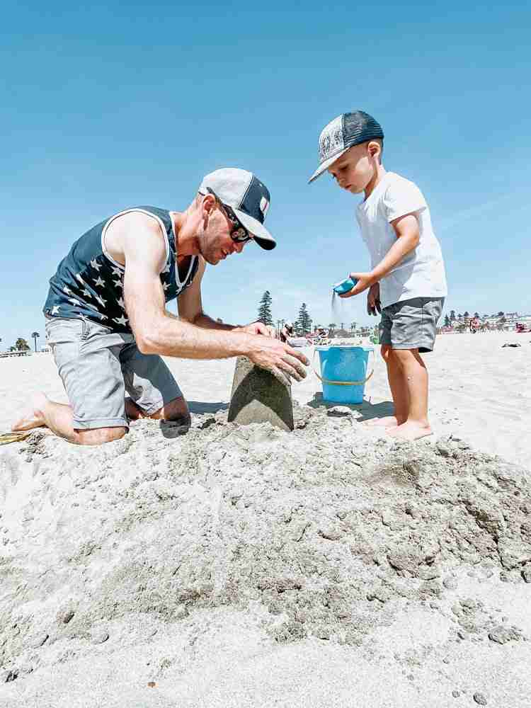 Father and son playing in sand is one of the best things to do on coronado island