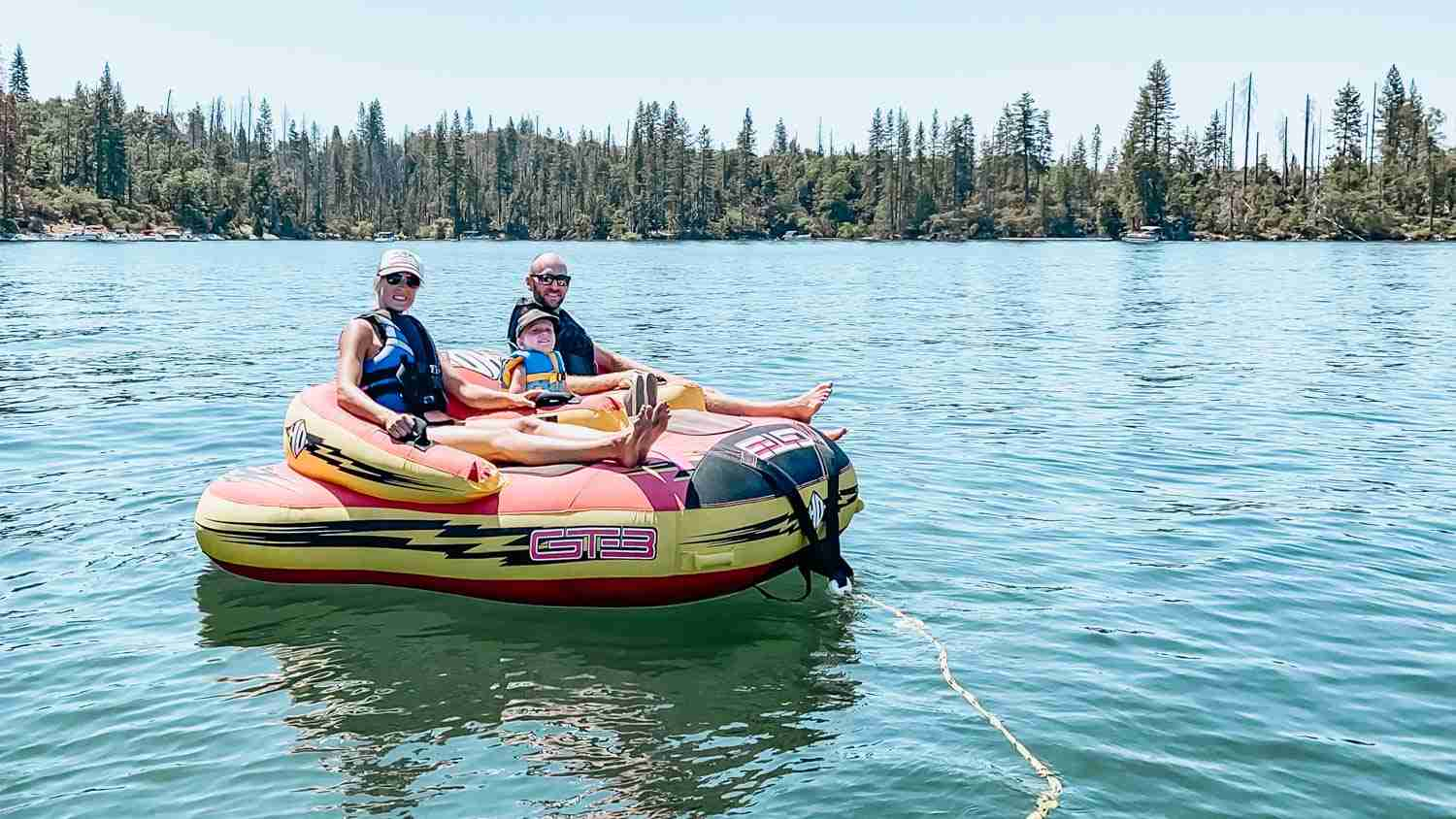 Family on tube on water on Bass Lake California