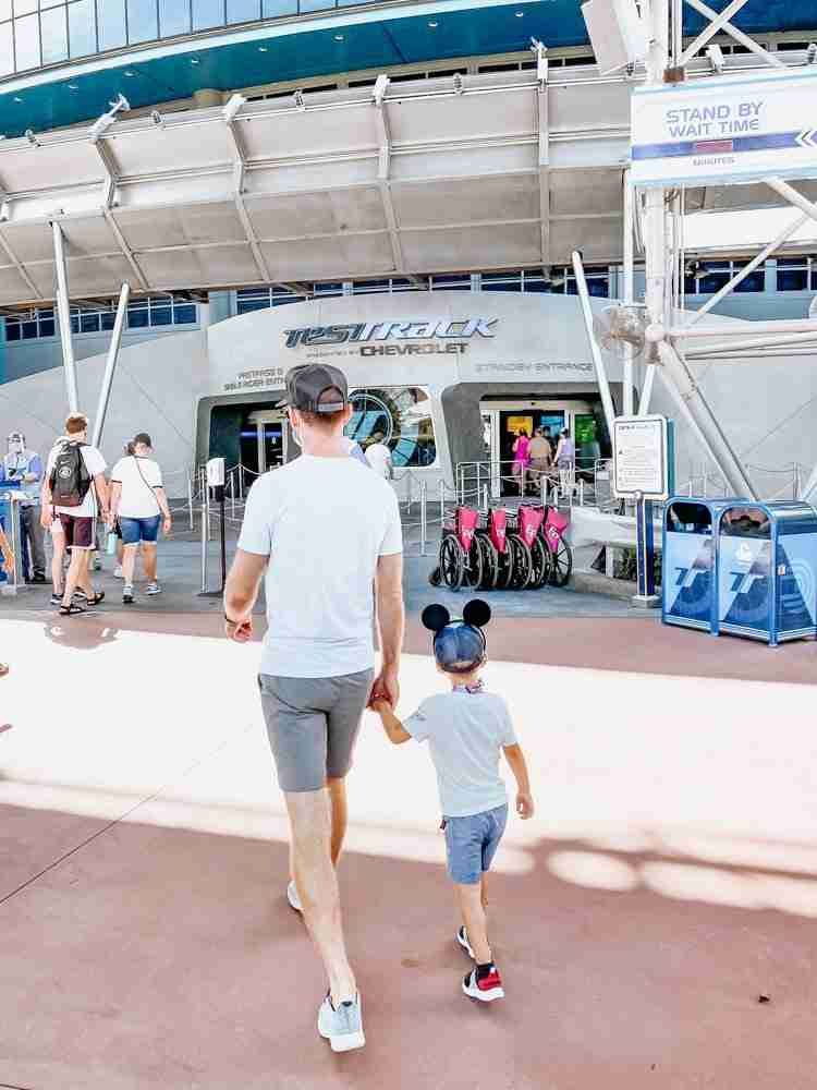 Father and son walking to the line for Test Track at EPCOT