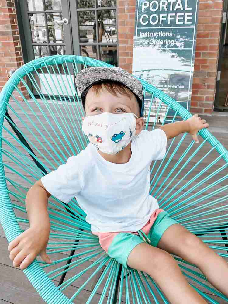 Little boy wearing masks at coffee shop