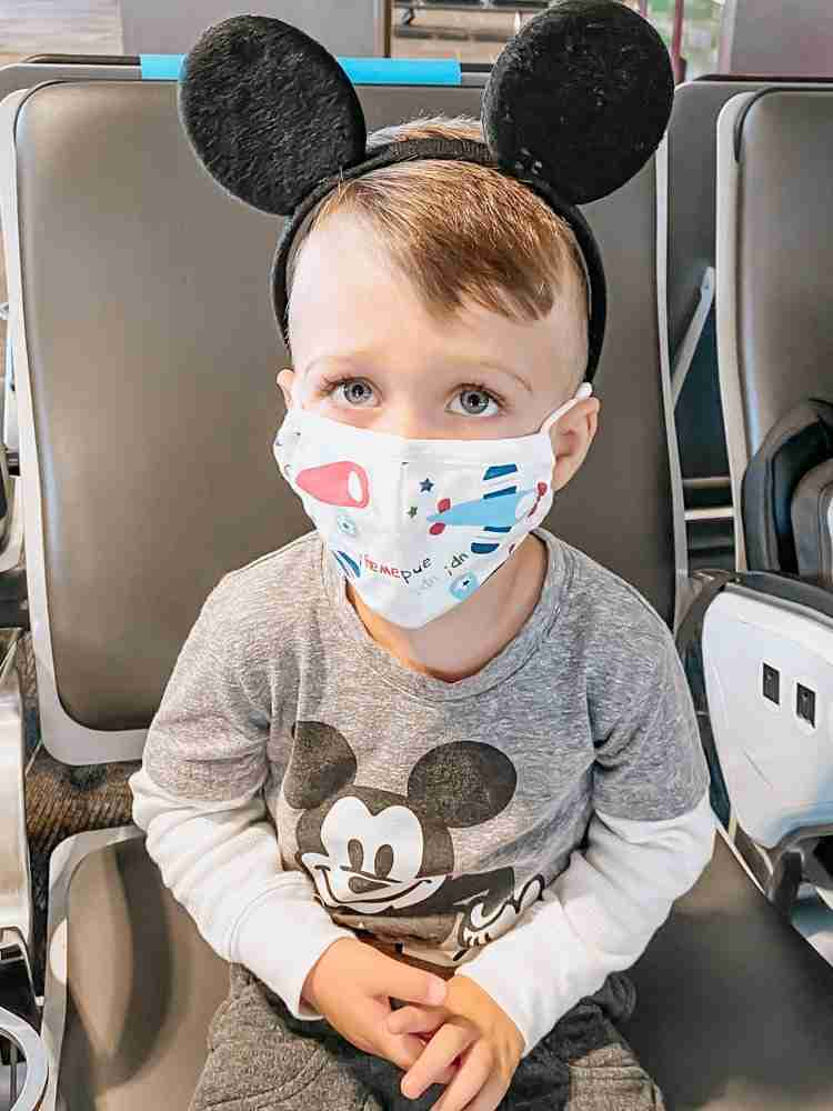 Little boy wearing masks with airplanes