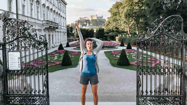 Reenacting Sound of Music poses at Mirabell Gardens in Salzburg