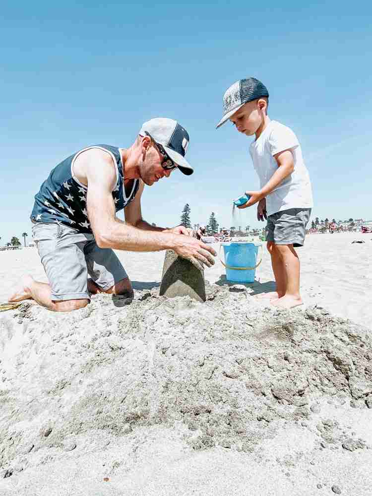 Father and Son building a san castle