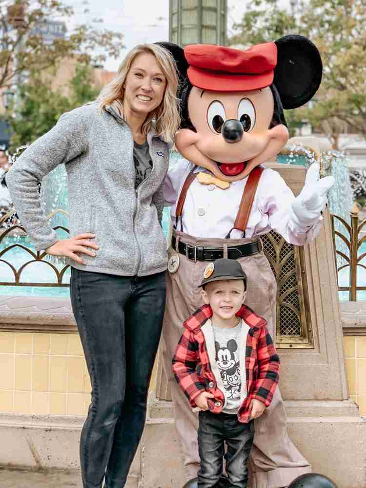 Mom and son at Disneyland with Mickey Mouse