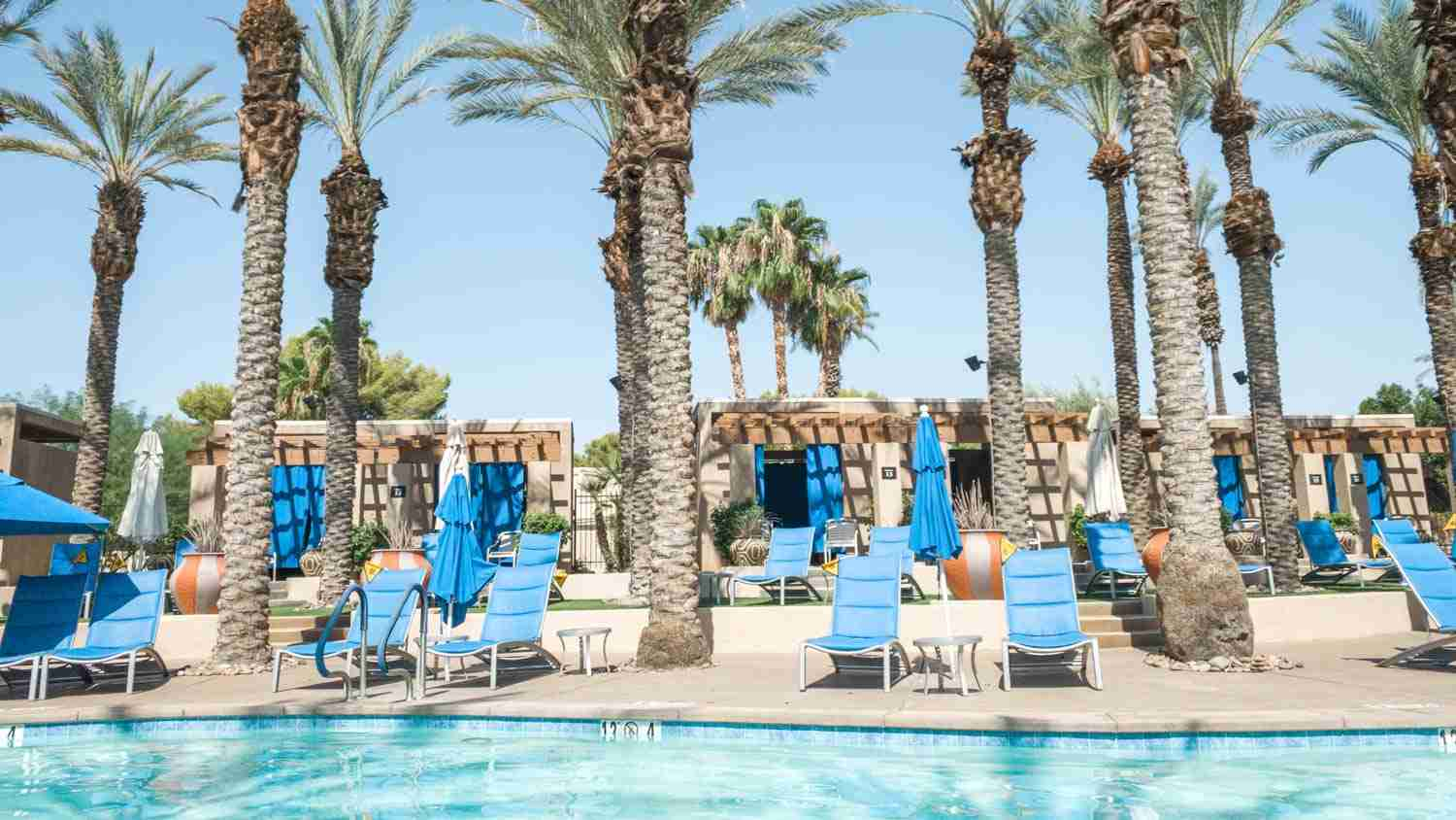 Pool, lounge chairs, and cabanas at Palm Springs resort