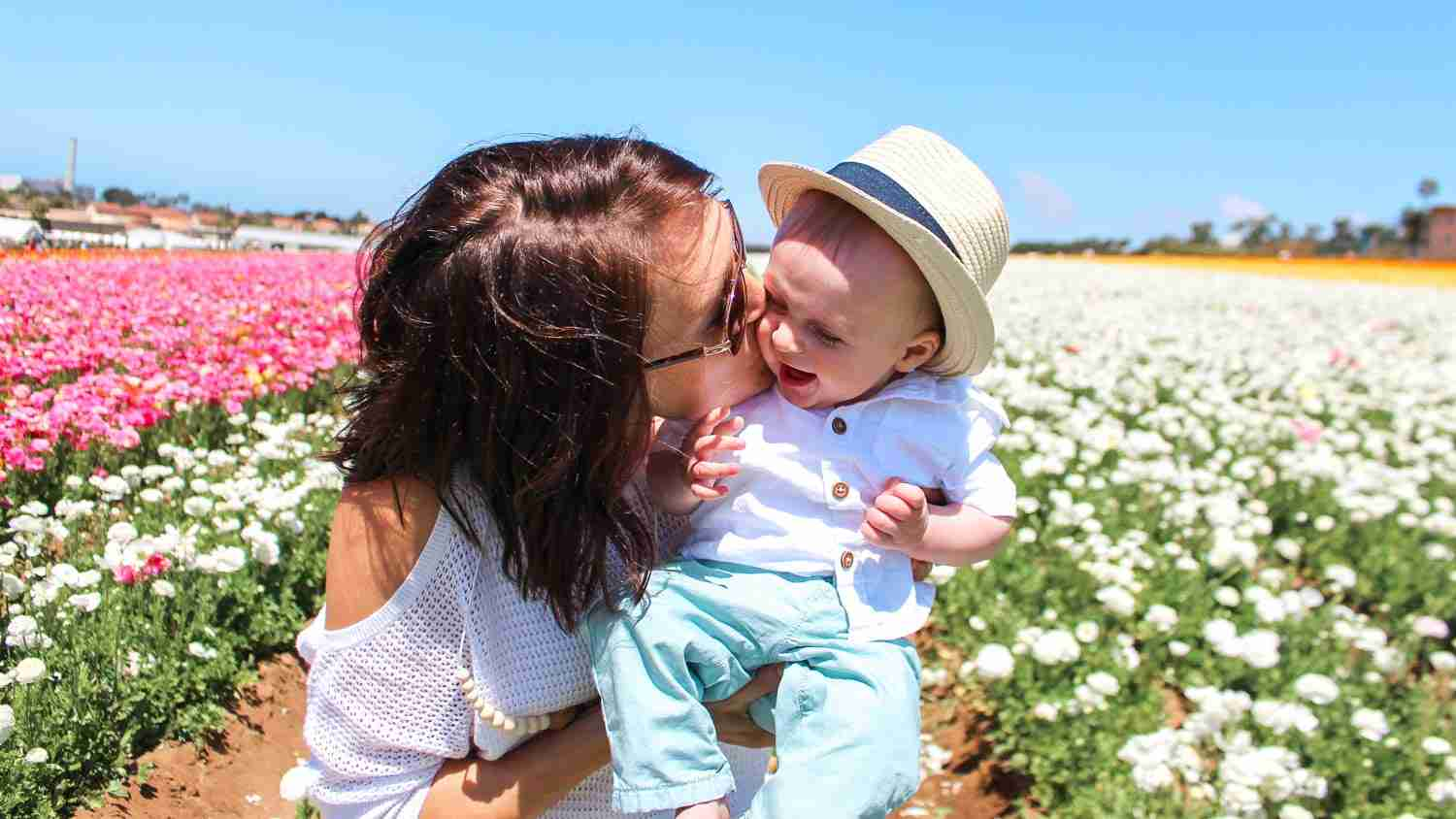 Mother and son in field of ranunculas at the Flower Fields in Carlsbad