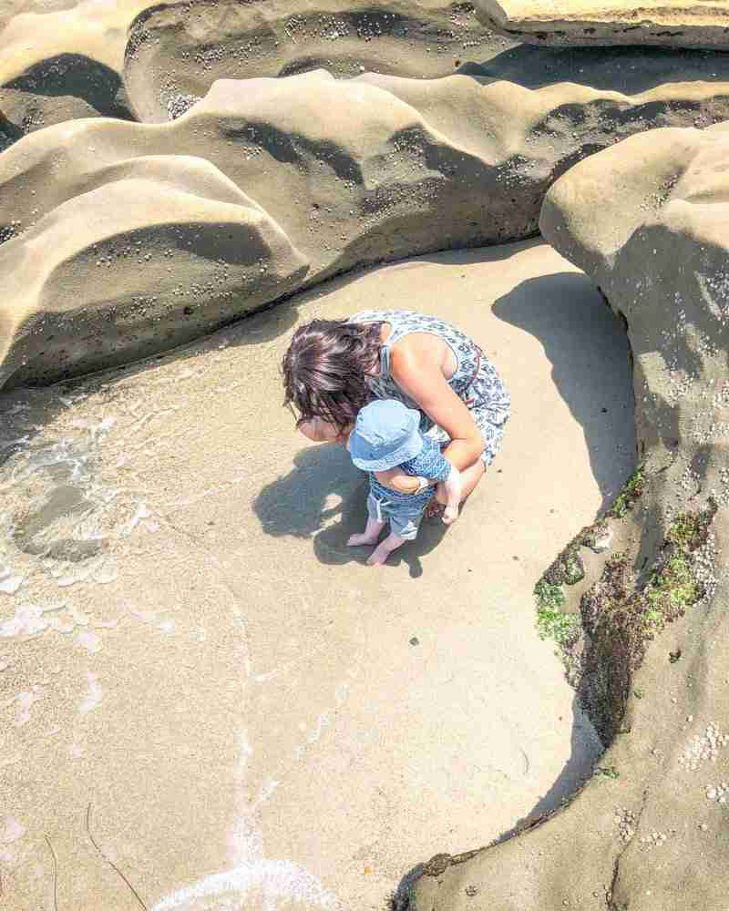 Mother and baby on the beach of the La Jolla Tide Pools in San Diego