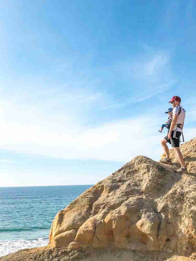 Father and son hiking on the cliffs at Torrey Pines State Reserve overlooking the ocean